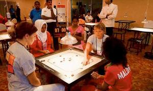 Art-of-playing-Carrom