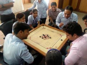 Employees playing Carrom during the intra - department tournament